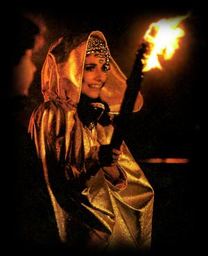 Babetta in Japan performing a ritual with fire